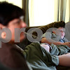 Kyle Bursaw – kbursaw@shawmedia.com<br /> <br /> Jacob Gable, 13, uses his mother's iPad while home sick from school on Wednesday, Aug. 29, 2012. His mother, Stacy Gable watches television from the same room and she and her husband Earl, who have three children ages 13 to 16, require that all their children give them their passwords for sites such as facebook, twitter and instagram so that they can monitor them.