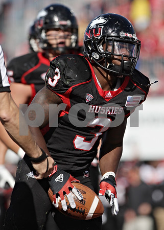 Rob Winner – rwinner@shawmedia.com<br /> <br /> Northern Illinois running back Akeem Daniels scores a touchdown on a 3-yard run during the second quarter at Huskie Stadium in DeKalb, Ill., on Saturday, Sept. 22, 2012. Northern Illinois defeated Kansas, 30-23.