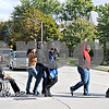 A group of Wheel-A-Thon participants cheer as they cross First Street in DeKalb after walking a two-mile course Saturday to raise money and awareness for DeKalb County RAMP Center for Independent Living.<br /> <br /> By Nicole Weskerna - nweskerna@shawmedia.com