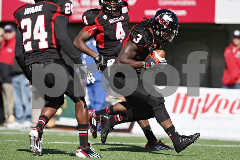 Rob Winner – rwinner@shawmedia.com<br /> <br /> Northern Illinois' Akeem Daniels downs a punt at the Kansas 3-yard line during the second quarter at Huskie Stadium in DeKalb, Ill., on Saturday, Sept. 22, 2012. Northern Illinois defeated Kansas, 30-23.