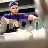 Kyle Bursaw – kbursaw@shawmedia.com<br /> <br /> Chef Alex Smith of Feed'Em Soup tosses diced onions into a mixture for meat loaf on Wednesday, Sept. 26, 2012 that was served for dinner that night.