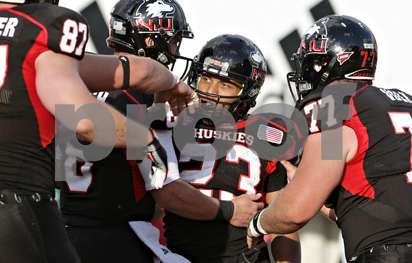 Rob Winner – rwinner@shawmedia.com<br /> <br /> Northern Illinois running back Leighton Settle (23) is congratulated by his teammates after a 2-yard touchdown run which would eventually be the game winning score at Huskie Stadium in DeKalb, Ill., on Saturday, Sept. 22, 2012. Northern Illinois defeated Kansas, 30-23.