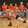Rob Winner – rwinner@shawmedia.com<br /> <br /> DeKalb's Abby Hickey lunges for a ball during the first game against Morris Tuesday, Sept. 25, 2012. DeKalb defeated Morris, 25-17 and 25-20.