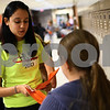 Kyle Bursaw – kbursaw@shawmedia.com<br /> <br /> Liza Vega, an eighth grade leader in Huntley Middle School's 'Where Everybody Belongs' group, hands out invitations to a tailgate the group in the sixth grade hallway after school on Wednesday, Sept. 19, 2012.