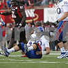 Rob Winner – rwinner@shawmedia.com<br /> <br /> Kansas quarterback Dayne Crist gets up off the turf after being hit on a pass attempt late during the fourth quarter in DeKalb, Ill., on Saturday, Sept. 22, 2012. Northern Illinois defeated Kansas, 30-23.