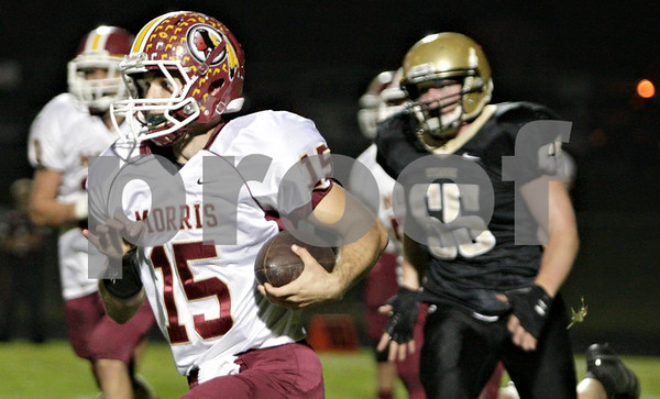 Rob Winner – rwinner@shawmedia.com<br /> <br /> Morris quarterback Zach Cinnamon carries the ball on the ground during the first quarter in Sycamore Friday, Sept. 28, 2012.