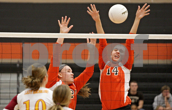 Rob Winner – rwinner@shawmedia.com<br /> <br /> DeKalb's Courtney Wagner (14) tips a ball during the second game against Morris Tuesday, Sept. 25, 2012. DeKalb defeated Morris, 25-17 and 25-20.