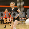 Rob Winner – rwinner@shawmedia.com<br /> <br /> DeKalb libero Nicole Schladt (9) watches a ball fall out-of-bounds for a Barbs' point during the first game against Morris Tuesday, Sept. 25, 2012. DeKalb defeated Morris, 25-17 and 25-20.
