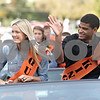 Rob Winner – rwinner@shawmedia.com<br /> <br /> Senior court members Rachel Butler and Andre Harris acknowledge the crowd on North Third Street before the start of DeKalb High School homecoming parade in downtown DeKalb on Thursday evening.