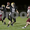 Rob Winner – rwinner@shawmedia.com<br /> <br /> Sycamore quarterback Devin Mottet throws on the run before having his pass intercepted during the first quarter in Sycamore Friday, Sept. 28, 2012.