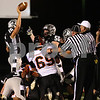 Kyle Bursaw – kbursaw@shawmedia.com<br /> <br /> Kaneland linebacker Blake Bradford emerges with a recovered fumble in the first quarter of the game at Kaneland High School on Friday, Sept. 28, 2012.