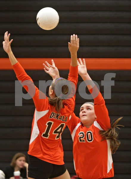 Rob Winner – rwinner@shawmedia.com<br /> <br /> DeKalb's Madison Lord (20) sets the ball for teammate Courtney Wagner (14) during the first game against Morris Tuesday, Sept. 25, 2012. DeKalb defeated Morris, 25-17 and 25-20.