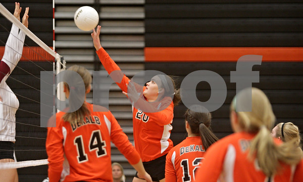 Rob Winner – rwinner@shawmedia.com<br /> <br /> DeKalb's Madison Lord (20) tips the ball over the net for a point during the first game against Morris Tuesday, Sept. 25, 2012. DeKalb defeated Morris, 25-17 and 25-20.