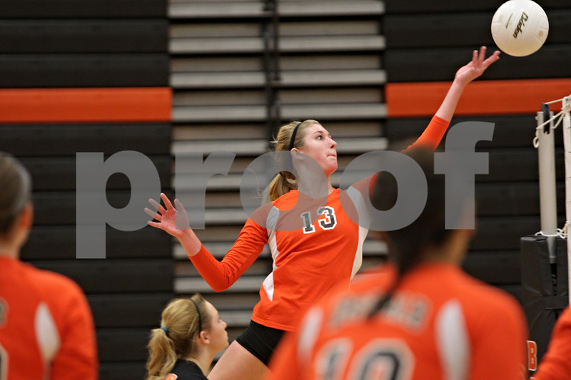 Rob Winner – rwinner@shawmedia.com<br /> <br /> DeKalb's Courtney Bemis (13) tips a ball over the net during the second game against Morris Tuesday, Sept. 25, 2012. DeKalb defeated Morris, 25-17 and 25-20.