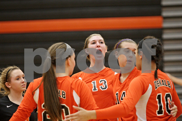 Rob Winner – rwinner@shawmedia.com<br /> <br /> DeKalb's Courtney Bemis (13) celebrates with her teammates after a Barbs' point during the second game against Morris Tuesday, Sept. 25, 2012. DeKalb defeated Morris, 25-17 and 25-20.