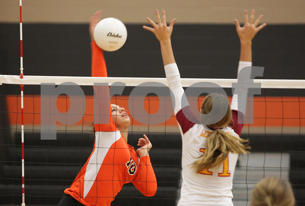 Rob Winner – rwinner@shawmedia.com<br /> <br /> DeKalb's Alexis Hammond (10) attempts a kill over Morris' Kendall Korte (11) during the second game against Morris Tuesday, Sept. 25, 2012. DeKalb defeated Morris, 25-17 and 25-20.