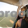 Kyle Bursaw - kbursaw@shawmedia.com<br /> <br /> Morgan Dirienzo, 17, glances toward the DeKalb Taylor Municipal Airport as she practices different types of landings flying a small single-engine plane on Wednesday, Aug. 1, 2012.