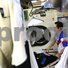 Kyle Bursaw – kbursaw@shawmedia.com<br /> <br /> Ricardo Gonzalez, of Greenacre Cleaners, finishes unloading a Columbia machine on Monday, Sept. 17, 2012, that uses no perchloroethylene. An Illinois law signed in August increases regulation on the chemical in dry cleaning businesses.