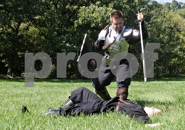 Rob Winner – rwinner@shawmedia.com<br /> <br /> Ryan Harden (top), of Sheboygan, Wis., finishes off Brian Raab, of Madison, Wis.,   during a live action role playing event at Stonehouse Park in Earlville Saturday.