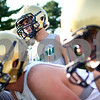Kyle Bursaw – kbursaw@shawmedia.com<br /> <br /> Hiawatha running back Dakotah Quimby listens to the call in a huddle at practice on Thursday, Sept. 6, 2012.