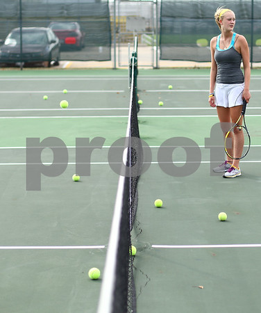 Kyle Bursaw – kbursaw@shawmedia.com<br /> <br /> After running out of tennis balls to practice with, Sycamore's Caitlin Mereness goes to retrieve some near the net at practice on Wednesday, Sept. 5, 2012.