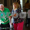 Kyle Bursaw – kbursaw@shawmedia.com<br /> <br /> Restorative Nurse Tatia Dugger helps Jim Rodgers walk around the inside of the Bethany Health Care and Rehabilitation Center during a group walking session on Wednesday, Sept. 26, 2012, part of a week-long event dedicated to promoting active aging.