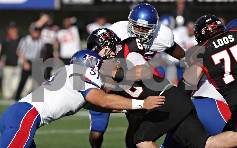 Rob Winner – rwinner@shawmedia.com<br /> <br /> Kansas linebacker Anthony McDondald (51) hits Northern Illinois quarterback Jordan Lynch after a 1-yard gain just before the end of the third quarter at Huskie Stadium in DeKalb, Ill., on Saturday, Sept. 22, 2012. Northern Illinois defeated Kansas, 30-23.