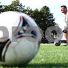 Kyle Bursaw – kbursaw@shawmedia.com<br /> <br /> John Ross, Northern Illinois University's women's soccer coach, takes a knee while observing his players doing a drill at practice on Tuesday, Sept. 25, 2012.
