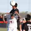 Kyle Bursaw – kbursaw@shawmedia.com<br /> <br /> Harvard's Isaih Soils heads a ball over Genoa-Kingston's Cristian Camargo (14) during the first half of the game. Harvard defeated Genoa-Kingston 1-0 in Genoa, Ill. on Monday, Sept. 24, 2012.