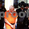 Kyle Bursaw – kbursaw@shawmedia.com<br /> <br /> Jack McCullough is escorted into the DeKalb County Courthouse by Sheriff's deputies Ray Nelson (back left) and David Rivers (front right) on Tuesday, Sept. 4, 2012.