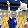 Kyle Bursaw – kbursaw@shawmedia.com<br /> <br /> Genoa-Kingston players Kara Dalby (left) and Torri Hensley (center) attempt to block a shot from Burlington Central during the first game of the Cogs 25-11, 25-22 loss to Burlington Central on Monday, Sept. 10, 2012.