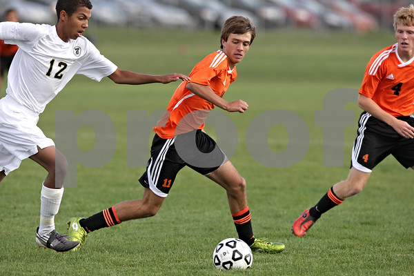 Rob Winner – rwinner@shawmedia.com<br /> <br /> Sycamore's Kendryck Rand (12) and DeKalb's Trevor Freeland (11) look to control a ball during the first half at Sycamore Tuesday afternoon. DeKalb defeated Sycamore, 4-0.