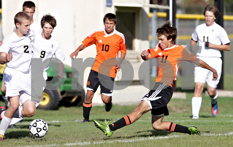 Rob Winner – rwinner@shawmedia.com<br /> <br /> DeKalb's Trevor Freeland (11) kicks in the Barbs' first goal during the first half at Sycamore Tuesday afternoon. DeKalb defeated Sycamore, 4-0.