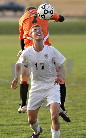 Rob Winner – rwinner@shawmedia.com<br /> <br /> Sycamore's Dylan Schmidt (17) and DeKalb's Will Ferguson (7) look to control a ball during the second half in Sycamore Tuesday afternoon. DeKalb defeated Sycamore, 4-0.