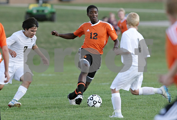 Rob Winner – rwinner@shawmedia.com<br /> <br /> DeKalb's Eric Ngum (12) controls a ball during the first half at Sycamore Tuesday afternoon. DeKalb defeated Sycamore, 4-0.