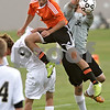 Rob Winner – rwinner@shawmedia.com<br /> <br /> DeKalb's Trevor Freeland (11) goes up for a ball as Sycamore goalkeeper Stephen Benson (right) makes the save during the second half in Sycamore Tuesday afternoon. DeKalb defeated Sycamore, 4-0.