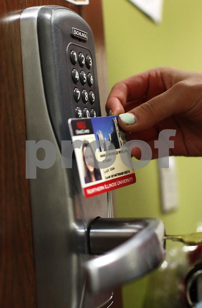 Kyle Bursaw - kbursaw@shawmedia.com<br /> <br /> Angela Versluis waves her OneCard by the keypad to her cluster, after which she has to also promptly type in a code to enter, then use a key to get into her shared bathroom and private room.