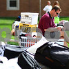 Kyle Bursaw - kbursaw@shawmedia.com<br /> <br /> Bob Coyne checks his cell phone while sitting on the lawn outside of New Residence Hall with his daughter Sam Coyne's belongings while she goes through the check in process on Thursday, Aug. 23, 2012.