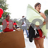 Kyle Bursaw - kbursaw@shawmedia.com<br /> <br /> Outside the front of New Residence Hall East, NIU juniors Hailey Shelton (left) and Lucy Albers look around for an extra pair of hands to bring the last of Albers things to her room on Thursday, Aug. 23, 2012.