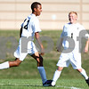 Kyle Bursaw - kbursaw@shawmedia.com<br /> <br /> Sycamore players Kendryck Rand (12) and Adam Millburg (1) celebrate a Sycamore goal in the first half against Sandwich at Sycamore High School on Monday, Aug. 27, 2012.
