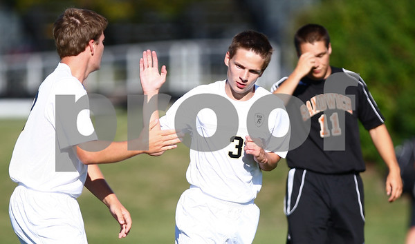 Kyle Bursaw - kbursaw@shawmedia.com<br /> <br /> Sycamore's Chris Cortell (left) and Alex Larsen (3) celebrate Cortell's goal putting the Spartans up 5-0 as Sandwich's Alex Linden (11) reacts behind them in the first half at Sycamore High School on Monday, Aug. 27, 2012.