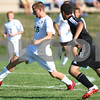 Kyle Bursaw - kbursaw@shawmedia.com<br /> <br /> Sycamore's Jakob Brown passes upfield in the first half against Sandwich at Sycamore High School on Monday, Aug. 27, 2012
