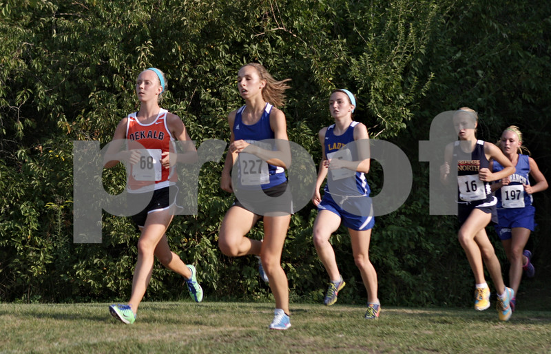 Rob Winner – rwinner@shawmedia.com<br /> <br /> Early on during the Sycamore Invitational DeKalb's Kelsey Schrader (left) leads all runners at Afton Forest Preserve Tuesday.