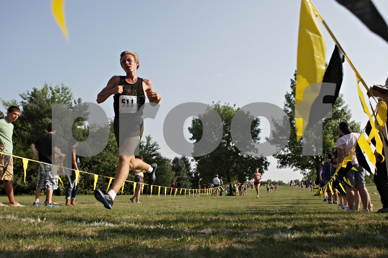 Rob Winner – rwinner@shawmedia.com<br /> <br /> Sycamore's Mark Stice crosses the finish line during the Sycamore Invitational at Afton Forest Preserve Tuesday.