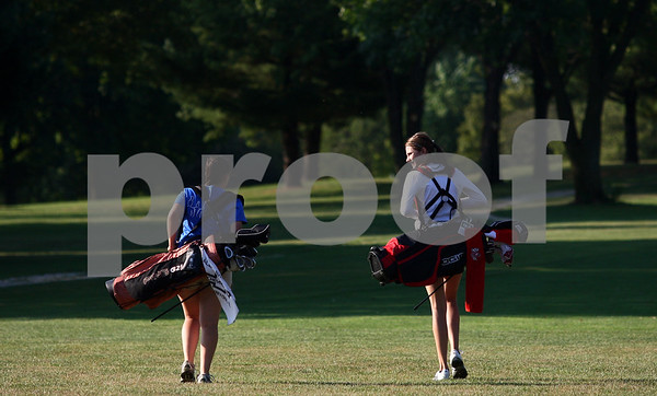 Kyle Bursaw - kbursaw@shawmedia.com<br /> <br /> Genoa-Kingston golfers Angel Cassidy (left) and Andrea Strohmaier chat as they walk the fairway at the Oak Club golf course in Genoa, Ill. on Friday, Aug. 10, 2012.