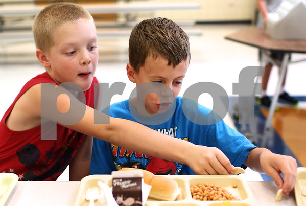 Kyle Bursaw - kbursaw@shawmedia.com<br /> <br /> Fourth-graders Cody Peterson and Edward Peters play with their animal crackers during lunch period at Genoa Elementary on Thursday, Aug. 16, 2012.