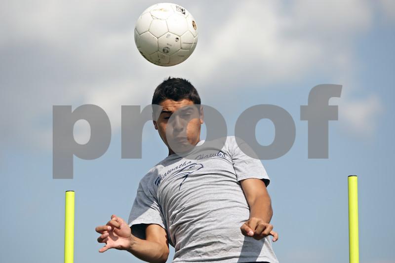 Rob Winner – rwinner@shawmedia.com<br /> <br /> Reyman Solis of Hiawatha heads a ball during a drill at practice in Kirkland, Ill., Tuesday, Aug. 14, 2012.