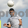 Rob Winner – rwinner@shawmedia.com<br /> <br /> Reyman Solis of Hiawatha heads a ball during a drill at practice in Kirkland, Ill., Tuesday, Aug. 14, 2012.