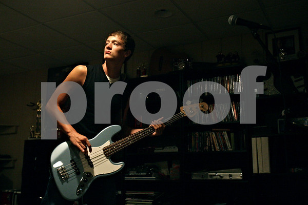 Rob Winner – rwinner@shawmedia.com<br /> <br /> Desolation Row band member Jacob Hoey, 16, plays bass during band practice in Rockford, Ill., Thursday, Aug. 9, 2012. The band recently won the Sycamore Park District's Battle of the Bands competition and will perform at the Illinois State Fair in Springfield.