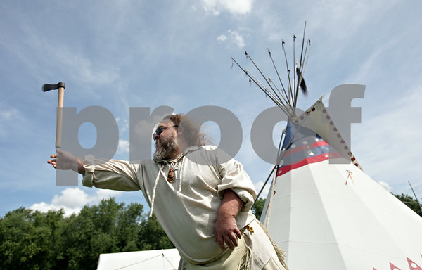 Rob Winner – rwinner@shawmedia.com<br /> <br /> John Tolliver, of DeKalb, tosses an axe at a target during the Boy Scout Troop 33 Living History event at Kiwanis Park in DeKalb Saturday, Aug. 18, 2012.